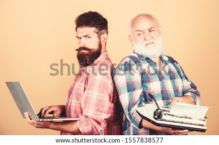 Modern life and remnants of past. Digital technologies. Battle of technologies. Master new technologies. Men work writing devices. Old generation. Senior man with typewriter and hipster with laptop. #1557838577