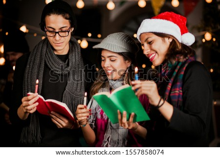 Mexican Posada, group of friends Singing carols in Christmas in Mexico