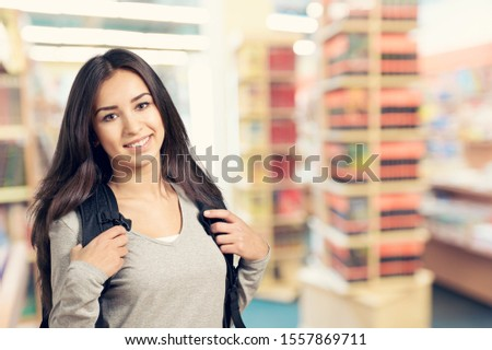 Portrait of a cute young student girl , isolated on background #1557869711