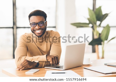 Happy Black Businessman Looking At Camera, Working With Pleasure, Selective Focus #1557916694