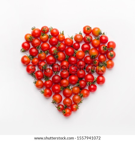 Diet and nutrition concept. Healthy heart picture of baby tomatoes isolated on white background