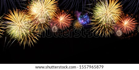 Fireworks colorful explosions on black, festive extra wide web banner background with copy space #1557965879