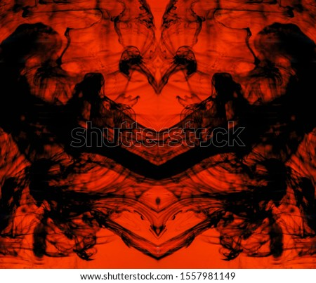 Blurred abstract background. Colorful inks in the water. Splash paint mixing. Watercolor effects. Ink pattern in Rorschach test style.  #1557981149