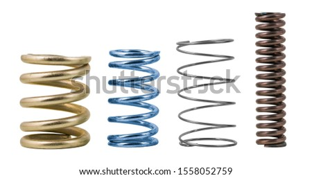 Four steel compression coil springs with varied surface finish isolated on white background. Springy metallic machine parts. Set of different flexible elastic shock absorbers with spiral wire winding. #1558052759