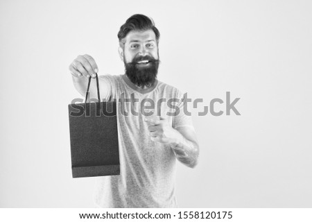 Man with purchase. Impulse purchase. Purchase concept. Male motives for shopping appear to be more utilitarian. Aspects can influence customer decision making behavior. Hipster hold shopping bag. #1558120175
