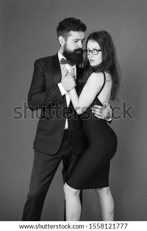 temptation. sexy couple in love. formanl couple in tuxedo and black dress. elegant fashion and beauty. romantic date. business partnership. formal event. temptation and desire. temptation couple. #1558121777