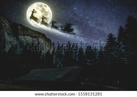 noise pic,Merry Christmas and happy holidays. Santa Claus flying in his sleigh against moon sky.