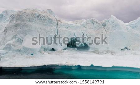 Greenland Iceberg landscape of Ilulissat icefjord with giant icebergs. Icebergs from melting glacier. Arctic nature. #1558149791