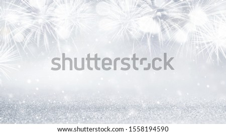 Silver and white Fireworks and bokeh in New Year eve and copy space. Abstract background holiday. #1558194590
