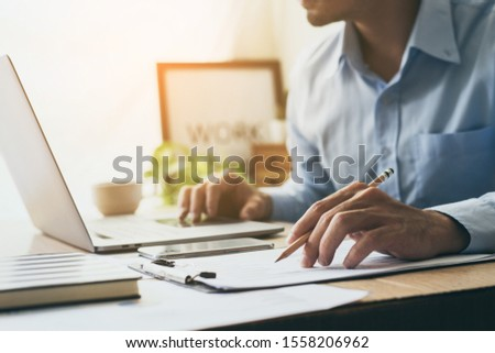 contact professional people thinking while working writing information documents in home offices at desk with computer,cell phone,business report chart #1558206962