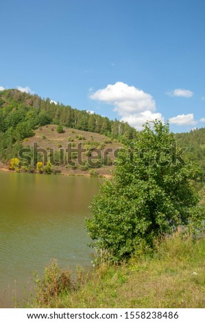 Summer landscape photography, rolling hills with a lake, Central Europe #1558238486