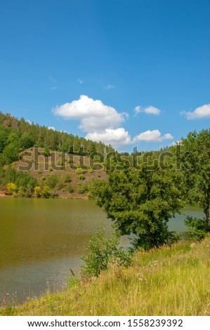 Summer landscape photography, rolling hills with a lake, Central Europe #1558239392