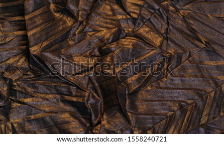 texture. background. template. wallpaper. black silk fabric with yellow golden stripes, wrinkled fabric #1558240721