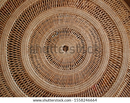 Circular weave rattan pattern Round Rattan Furniture Background Brown Texture Close-Up, Weave Rattan Texture And Background Royalty-Free Stock Photo #1558246664