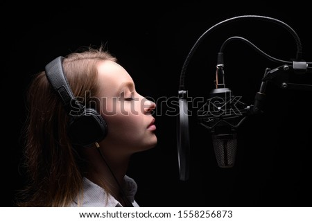 Singer, blogger, voice acting. Work in the studio with a studio microphone. #1558256873