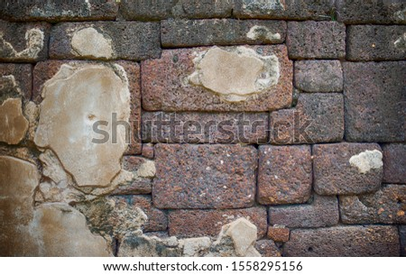 The surface of the background image is old worn out brick wall. #1558295156