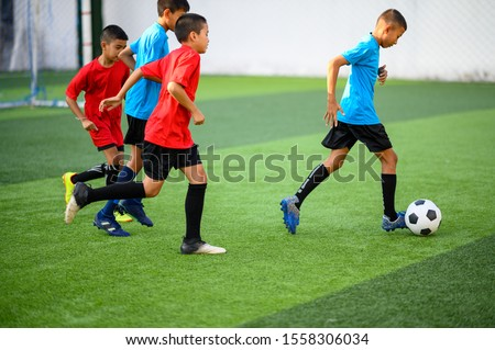 Boys playing football on the football practice field