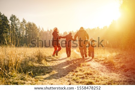 family running on country road in autumn time #1558478252