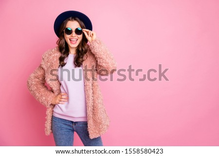 Photo of pretty youngster model lady going street enjoy watching sightseeing abroad wear stylish fluffy jacket jeans sun specs retro blue hat isolated pink background #1558580423