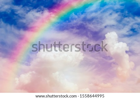 Entering the Heaven, blurred defocused photo of sky and rainbow. Unfocused Heaven gates to Paradise in clouds, God path. Dramatic light. Gateway to the garden of Eden Royalty-Free Stock Photo #1558644995
