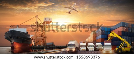 Container truck in ship port for business Logistics and transportation of Container Cargo ship and Cargo plane with working crane bridge in shipyard, logistic import export and transport #1558693376