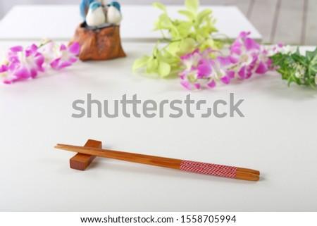 Japanese chopsticks on a chopstick rest. #1558705994