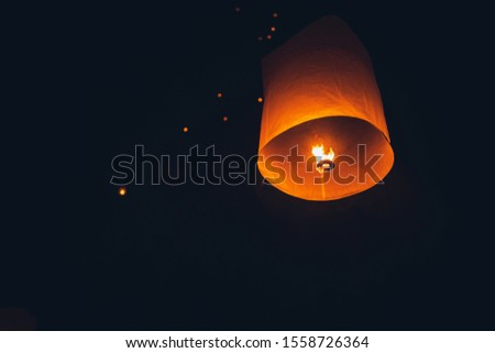 Lighting candles, lanterns in the sky at night in the Lantern Festival #1558726364