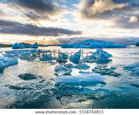 Travel concept. Beautiful sunset over the famous glacier lagoon  Jokulsarlon, view of icebergs floating. Location: Jokulsarlon glacier lagoon, Iceland. Artistic picture. Beauty world.