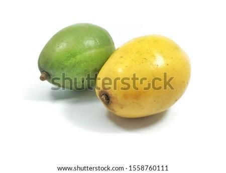 close up view kedondong fruit or Spondias dulcis yellow and green fresh white background