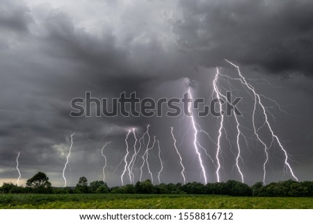This is a picture of the breathtaking thunderstorm with some lightning strikes in Austria.
