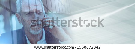 Mature man using his mobile phone, light effect, double exposure; panoramic banner #1558872842