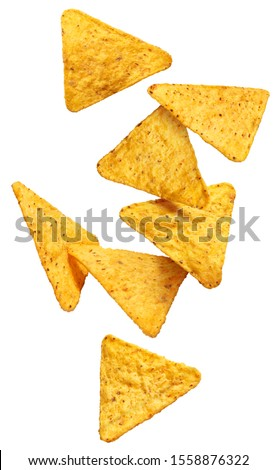 Flying mexican nachos chips, isolated on white background Royalty-Free Stock Photo #1558876322
