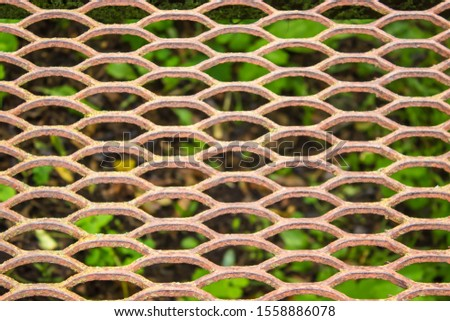 Part of the bridge in the form of a rusty grill. Rusty grill background.Rusty grill background. #1558886078