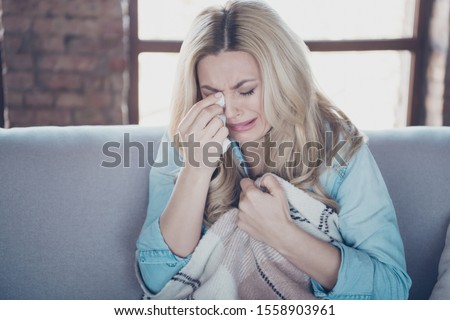 Close-up portrait of her she nice attractive sad disappointed miserable wavy-haired lady sitting on divan wiping tears crying break-up with boyfriend at industrial loft brick style interior room #1558903961