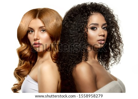 Multi-ethnic beauty. Caucasian and African. Different ethnicity women on white background. Beautiful vogue girls. #1558958279