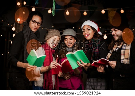 Mexican Posada, Mexican friends Singing carols in Christmas in Mexico