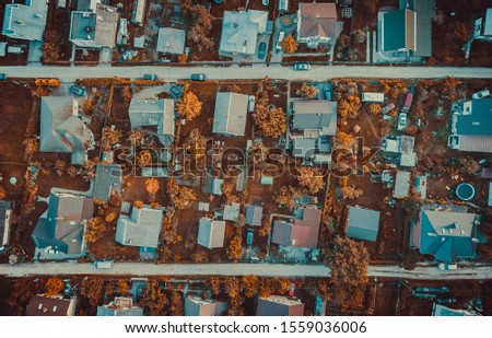 Small houses in Carnikava city. Shot from above by drone Royalty-Free Stock Photo #1559036006