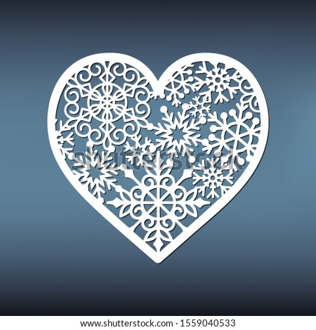 Template of snowflakes heart for laser cutting. Christmas pattern for love card or engagement.  Paper vector illustration. Stencil for holiday decor. Element for the winter garland. #1559040533