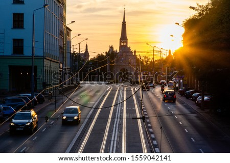 Traffic in Szczecin during a beautiful sunset Royalty-Free Stock Photo #1559042141