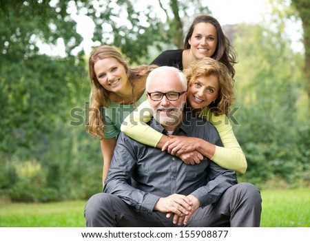 Fun portrait of a happy family laughing together outdoors #155908877