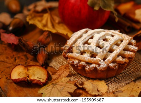 Arrangement of home-made apple pie in autumnal decor Royalty-Free Stock Photo #155909687