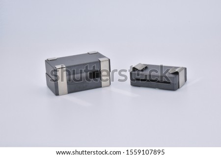 Split EMI Suppression Flat Ferrite with spring clip. Easy to mount on already installed cables or cables with plugs. Ferrite chokes on flat cables of digital devices for strong interference problems. #1559107895