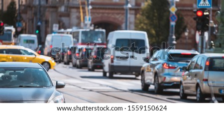 Cars in Traffic jam in crowded city street   #1559150624