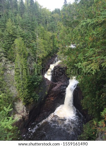 waterfalls in a park up the north shore Minnesota Royalty-Free Stock Photo #1559161490