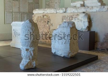Italy, Brescia - December 24 2017: the view of the columns' fragment in the lapidarium of the Capitolium in Brescia on December 24 2017 in Brescia, Lombardy, Italy. #1559222501