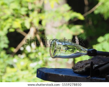 Glassblower demonstrates the art of making glassware #1559278850