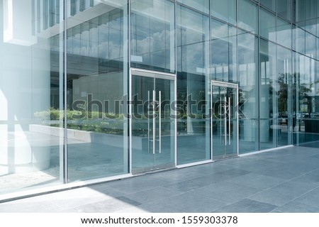 Empty ground in front of modern glass wall facade buildings . #1559303378