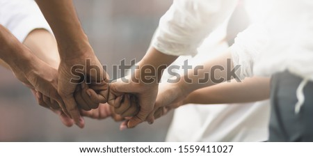 Panoramic teamwork business join hand together concept, Business team standing hands together, Volunteer charity work. People joining for cooperation success business. #1559411027