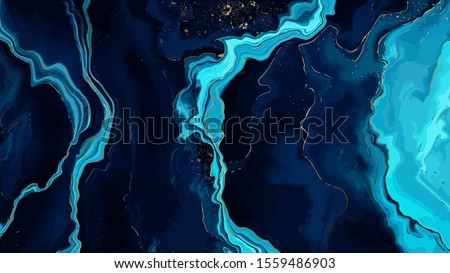 Blue marble and gold abstract background texture.  Indigo ocean blue marbling  with natural luxury style swirls of marble and gold powder. Royalty-Free Stock Photo #1559486903