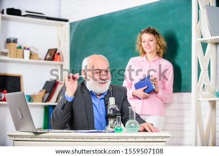 School time. biology lesson. Science and biotechnology research. mature teacher with microscope. student and tutor with laptop. chemistry education. back to school. student girl at blackboard. #1559507108